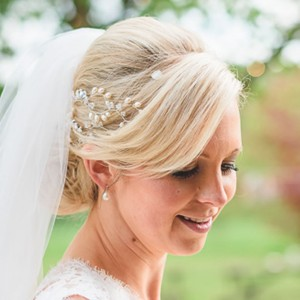 Wedding Bun Hairstyle With Fringe and Veil Blonde