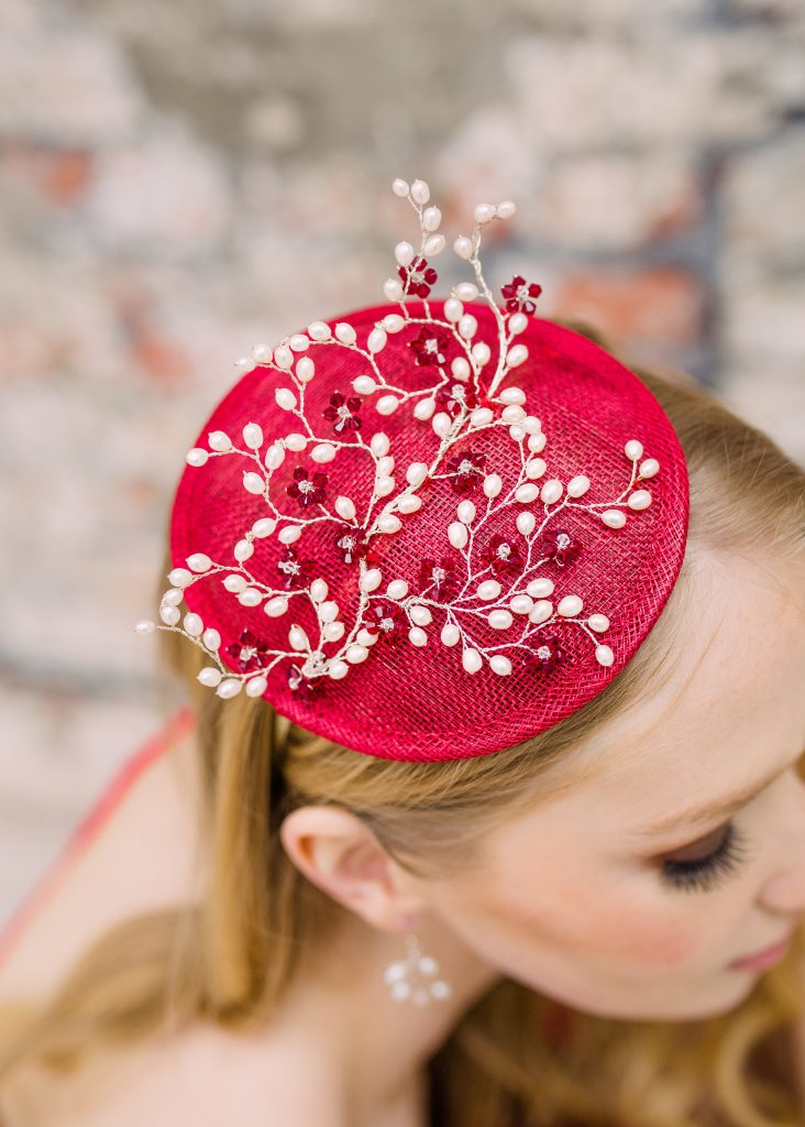 Ruby hat suitable for the Royal Enclosure at Royal Ascot