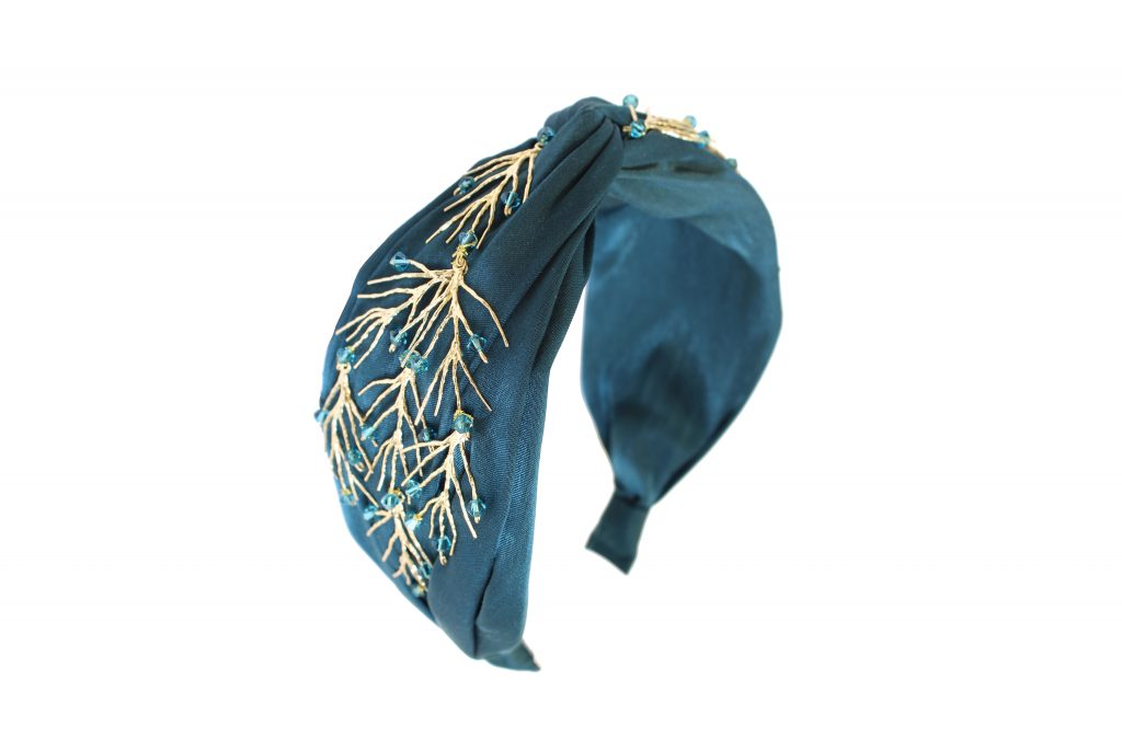 An embellished teal satin turban, a perfect party piece for any occasion
